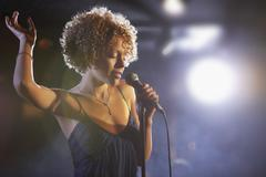 Female Jazz Singer On Stage - stock photo