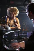 Singer And Pianist On Stage - stock photo