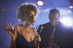 Jazz Singer And Saxophonist In Performance - stock photo