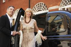 Couple Exiting London Taxi Stock Photos