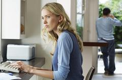 Stock Photo of Worried Woman Using Computer