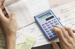 Expenses Being Calculated - stock photo