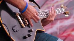 Rock band guitar palying Stock Footage