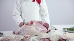 Wide shot of butcher in butchery working Stock Footage