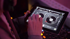 Dj playing on iPad app turntables Stock Footage