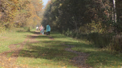 Mother and Kids Walking in Autumn Forest - stock footage