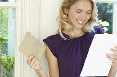 Happy Woman Looking At Letter Stock Photos