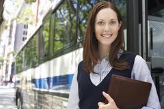 Smiling Businesswoman With Portfolio By Bus Stock Photos
