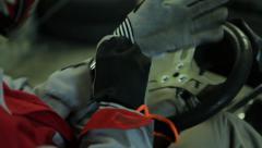 Kart driver wears gloves Stock Footage
