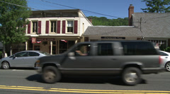 Store fronts along main street Stock Footage