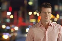 Stock Photo of Man On Sidewalk At Night