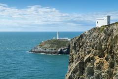 UK, Wales, Anglesey, Holy Island, cliff coast of South stack with lighthouse - stock photo