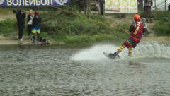 Performing tricks male, wakeboarding contest, towed by cable, click for HD Stock Footage