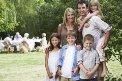 Happy Family Standing Together In Garden - stock photo