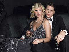 Couple With Champagne Flutes In Limo Stock Photos