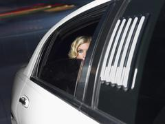 Female Celebrity Inside The Limo Car Stock Photos
