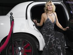 Woman In Evening Wear Getting Out Of Limousine Stock Photos
