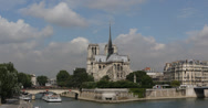 Stock Video Footage of Ultra HD 4K Paris Boat Seine River Ile de la Cite Iconic Notre Dame Cathedral