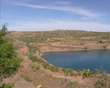 Pine Creek, Australia: Pan closed open-cut gold mine pit, filled with water Stock Footage