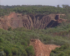 Pine Creek, Australia:  Close up gold mine on slope + zoom out Stock Footage