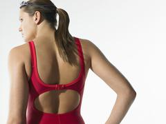 Rear View Of Female Swimmer In Red Swimwear Stock Photos