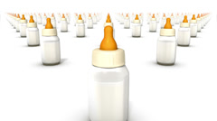 Dolly over many Baby Bottles to a single Bottle Stock Footage