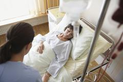 Nurse With Patient In Hospital Room - stock photo