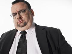 Portrait Of Overweight Businessman - stock photo