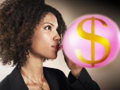 Businesswoman Blowing Balloon With Dollar Sign Stock Photos