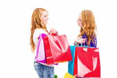 Stock Photo of two chatting redhead women with shopping bags