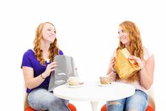 happy redhead women sitting at a coffee table with shopping bags - stock photo
