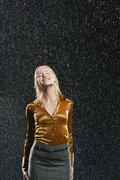 Businesswoman Standing In Rain - stock photo