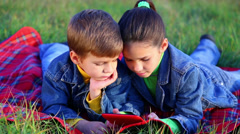 Two kids with tablet PC Stock Footage