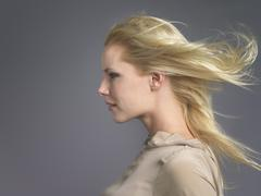 Woman With Blond Hair Blowing In Wind - stock photo