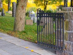 gate openens to oldish churchyard - stock photo