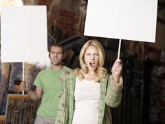 Young Couple With Blank Demonstration Placards Stock Photos