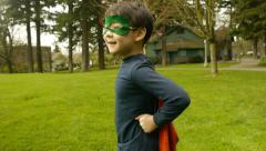 Little Boy Jumps Up and Down In His Superhero Costume - stock footage