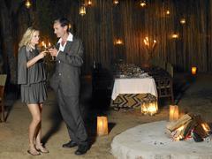 Couple Toasting At Outdoor Nightclub - stock photo