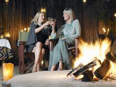 Women Toasting By Bonfire - stock photo