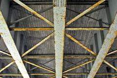Underside of bridge truss. - stock photo