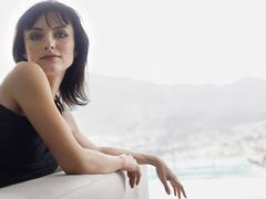 Portrait Of Woman Leaning On Couch - stock photo