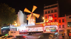 Moulin rouge at night, paris france 4k Stock Footage