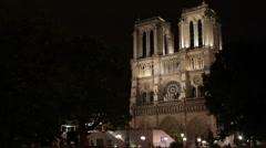 Illuminated Night Light Night Paris France Ile de la Cite Notre Dame Cathedral Stock Footage