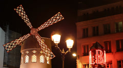 Illuminated Night Moulin Rouge Windmill Paris Can-Can Musical Show Performance Stock Footage