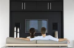 Couple Watching TV Together In Living Room - stock photo