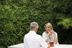 Stock Photo of Couple Having Wine At Lawn