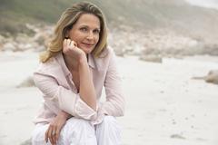Stock Photo of Beautiful Woman Relaxing At Beach