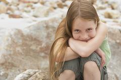 Cute Preteen Girl Sitting On Rock Stock Photos
