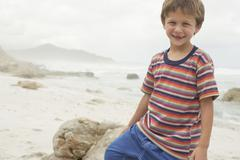 Boy Smiling On Beach Stock Photos