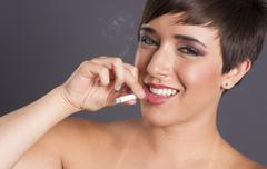intimate portrait female smoker addiction woman smoking cigarette smiling - stock photo